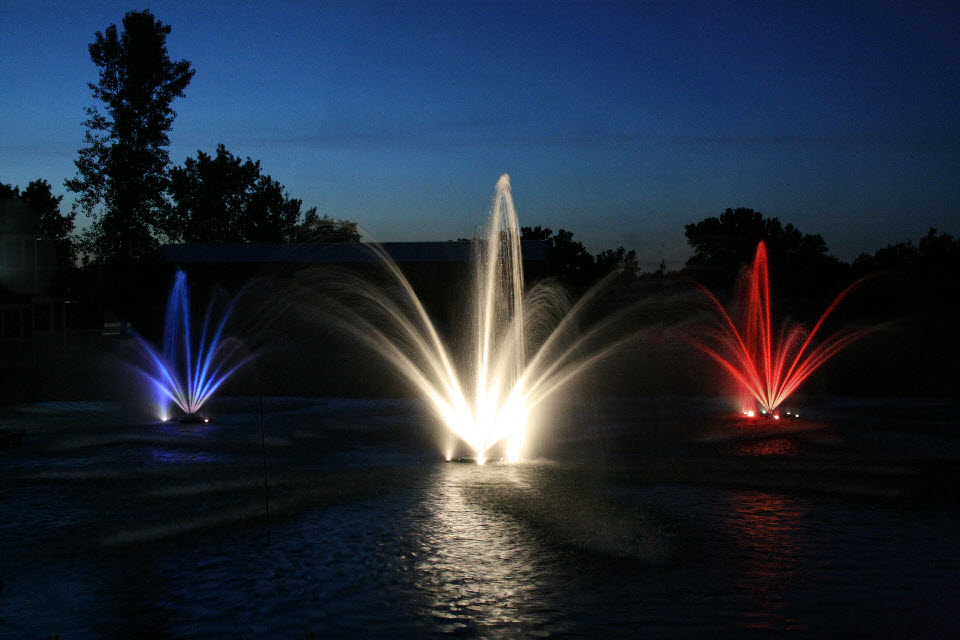 Colored lighting adds dramatic evening effects of Kasco fountains.